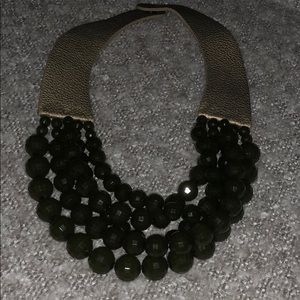 Green beaded statement necklace with faux leather
